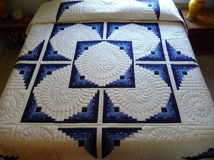 Traditional Hand Quilting Patterns : Log Cabin in the Round Quilt. Traditional Amish Log Cabin Quilt pattern with a twist. Gorgeous ...