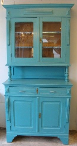 Love the shape of this cabinet...with the upper and lower section.  Would prefer the paint to be rubbed with diluted stain for a weathered look..   can imagine my mexican pottery on display.....