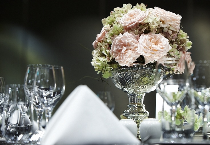 The simple elegance of silver chalis bowls filled with antique David Austin roses, green hydrangea and a touch of dodda vine at the InterContinental Melbourne. Flowers and styling by Victoria Whitelaw Beautiful Flowers.