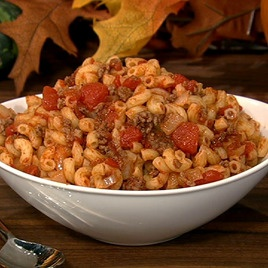 """Nannys' Goulash""  ---1/2 pound Elbow pasta   ---1 pound Ground beef   ---1 Onion sliced   ---2 tblsp Tomato paste  ---1 can diced tomatoes ---3 tblsp Parmesan cheese  ---Sprinkle: Salt, Pepper, Garlic powder, red chili flakes.  ~~~~Cook pasta. Cook meat, onions & seasoning. Then add diced & paste tomatoes to meat. Drain pasta & add to meat. Sprinkle with parmesan cheese."