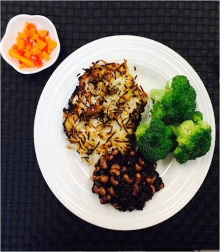 Coconut crusted organic chicken with black rice Hoppin' John served with a mango salsa & steamed broccoli