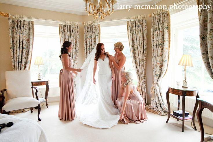 bridesmaids help bride get ready at tankardstown house