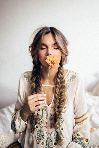 Check out these 25 boho hairstyles and get inspired to make your own version! Think of half up half down styles, loose braids, and flower hair accessories.