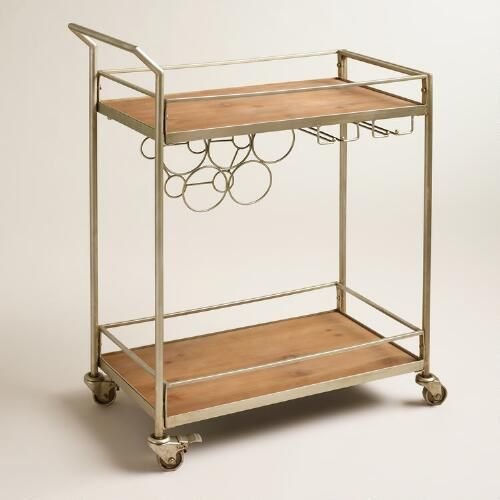 Complete your home bar setup with our sleek and stylish cart, crafted of wood and metal. With a built-in wine rack, this four-wheel cart is simple to assemble and can be stocked with spirits, mixers and other bar essentials. Great to have for parties, it's easily rolled from room to room.