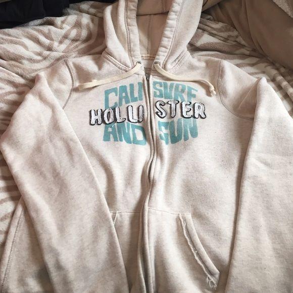 Hollister zip up hoodie Worn a few times. Beige zip up hollister hoodie. Hollister Tops Sweatshirts & Hoodies