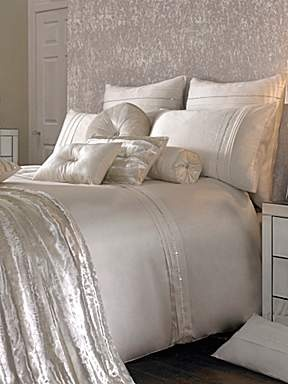 kylie minogue bedding love it! too bad I have a toddler and 2 cats. white bedding so pretty