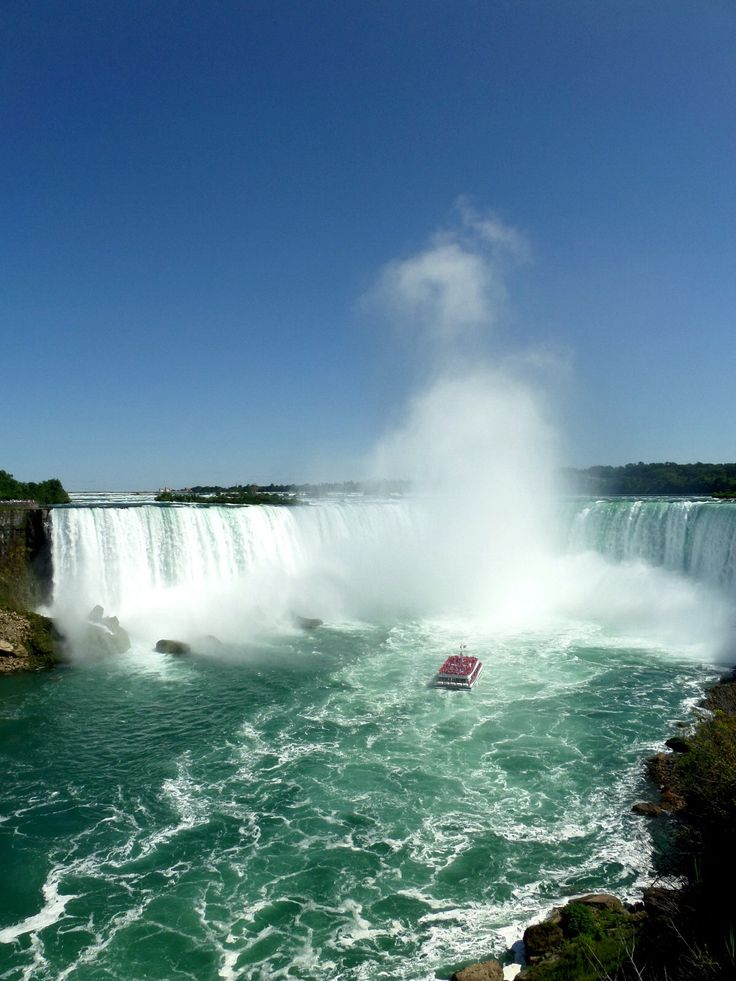 The spectacular Niagara Falls, Canada. Pictured: Maid of the Mist entering the mist