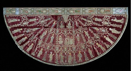 The Butler-Bowden Cope, 1330-1350, V Named for the family which owned it for centuries, it shows scenes of the Virgin's life w/apostles & saints, embroidered w/silver, silver-gilt thread & silk, on crimson velvet, the ideal base for Opus Anglicanum,  which was much coveted & used as a forceful visual statement of wealth & status. As w/many other medieval church vestments, this one was later cut up & remade into a variety of ecclesiastical garments, then re-assembled in the 19th c.