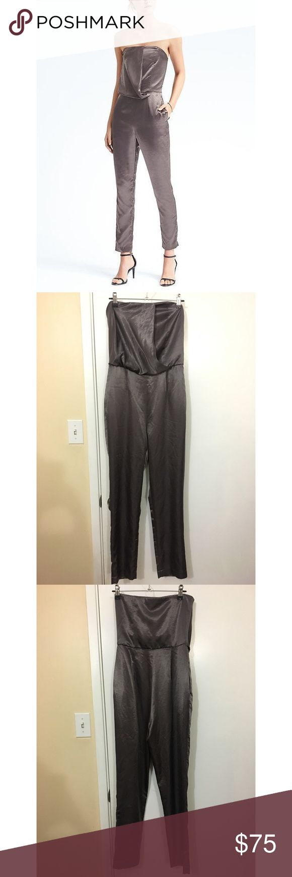 """Banana Republic Heritage Strapless Silver Jumpsuit Banana Republic Heritage line. Silver metallic. Strapless jumpsuit with pockets. Size zero (0).  100% polyester.  Never worn. Bought it to wear to Vegas but decided on something else. I'm 5'2"""" and it is long on my legs. Banana Republic Dresses"""