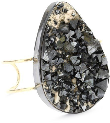 """Melissa Joy Manning """"New Elements"""" Magnetite Cuff Bracelet Melissa Joy Manning. $3190.00. One of a kind black sterling silver and 14k gold magnetite crystal cuff. This large magnetite crystal specimen is lovingly set in oxidized sterling silver. Sitting atop a 14 karat gold double bar cuff, this is a beautiful statement piece. A one of a kind item, this is exclusive to endless. Made in United States. Handmade in the artist's certified """"green"""" studio in California, ea..."""
