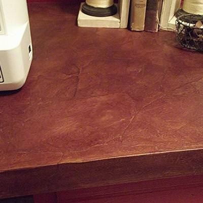 Faux Leather Desk Top {diy furniture}Did you know that you can create faux leather using wallpaper paste, torn brown paper and stain? Well you can! Come see how it's done.View This Tutorial
