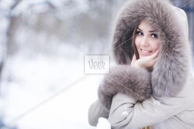 Young woman winter portrait Stock Photo - Veer.com