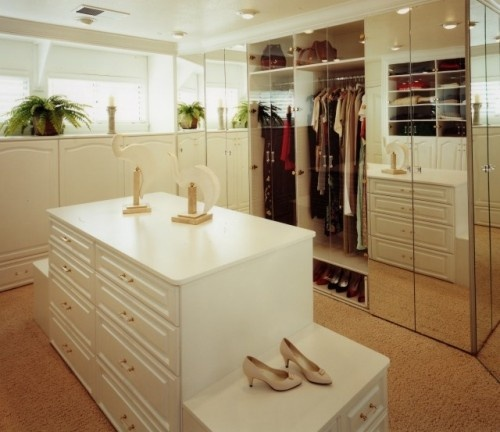 Like the bench seats- also like the idea of closet opening into bathroom with natural light flowing in.