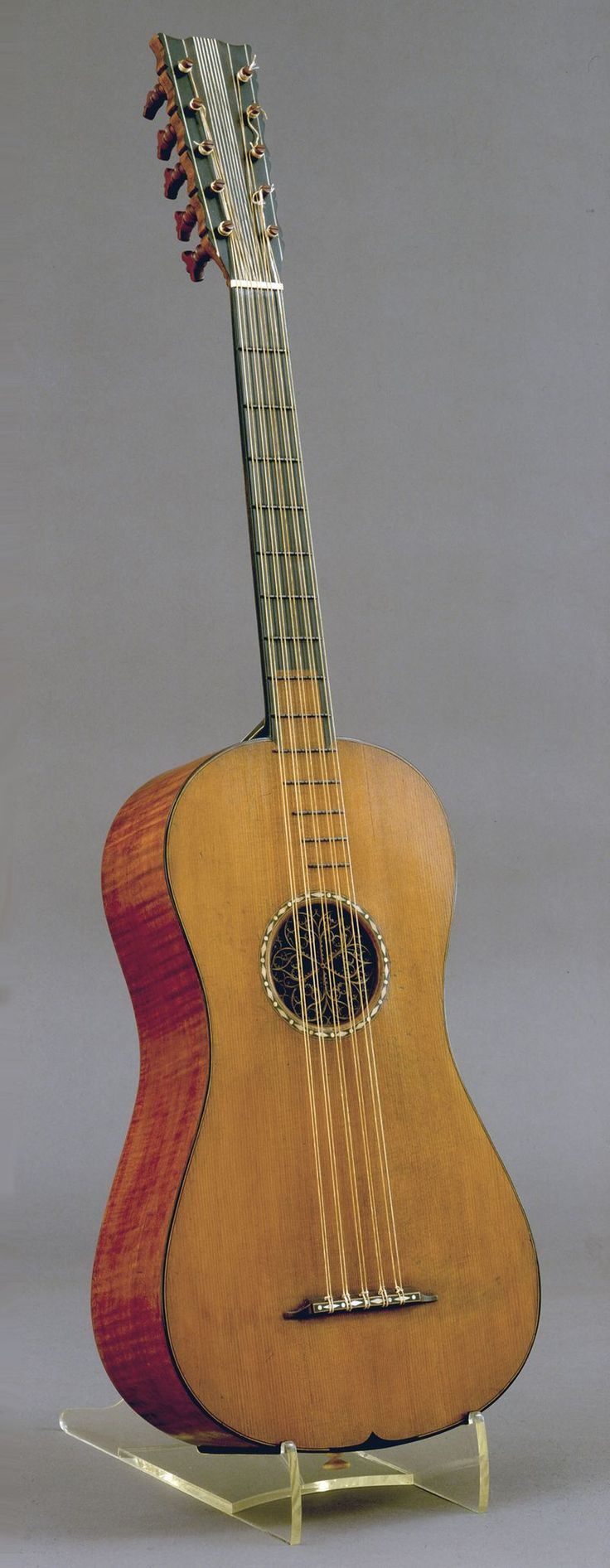 """Antonio Stradivari (1644–1737) """"The Rawlins"""" guitar, 1700, Cremona, Italy. The famed luthier (stringed instrument maker) Antonio Stradivari built a handful of guitars, of which four are known to survive. Stradivari's guitars are the earliest known guitars that use the same basic wood choices of spruce for the top and maple for the sides and backs.  These are the same woods used for violins, and are standard wood choices for modern day archtop guitar builders."""