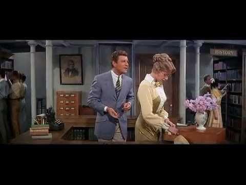 """The Music Man (1962) = Vivir de ilusión / Morton DaCosta.  """"Madam Librarian  What can I do, my dear, to catch your ear I love you madly, madly Madam Librarian... Marian"""""""