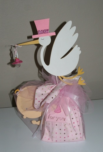 Stork Bundle... I love making these for gifts.  It has diapers, wipes, pacifier and receiving blanket.  Decorated with a paper crafted stork and a baby.