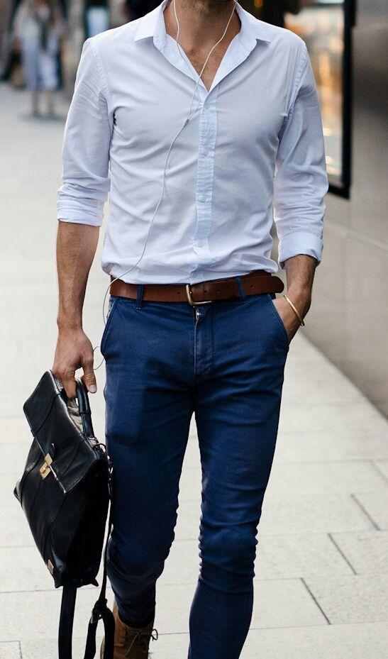 Shop this look on Lookastic:  https://lookastic.com/men/looks/dress-shirt-skinny-jeans-boots-briefcase-belt/13086  — Light Blue Dress Shirt  — Dark Brown Leather Belt  — Navy Skinny Jeans  — Black Leather Briefcase  — Brown Leather Boots