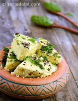 """These dhoklas are so soft and spongy that the reference to nylon is really apt! what is more, this recipe is also very easy to implement if you follow these simple instructions properly and practice it a bit. The addition of fruit salt to the batter, and water to the tempering, are the two main factors responsible for the super-soft and spongy nature of this dhokla. Temper just before serving, for the perfect """"100/100""""!"""