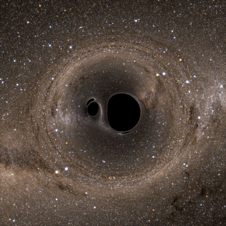 A binary black hole system, viewed from above. Image Credit: Bohn et al.