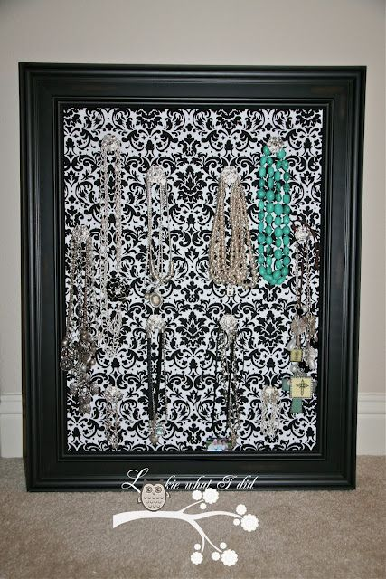 This is so clever… giant cheap picture frame, cut peg board to fit cover with fabric and add knobs to hang jewelry!