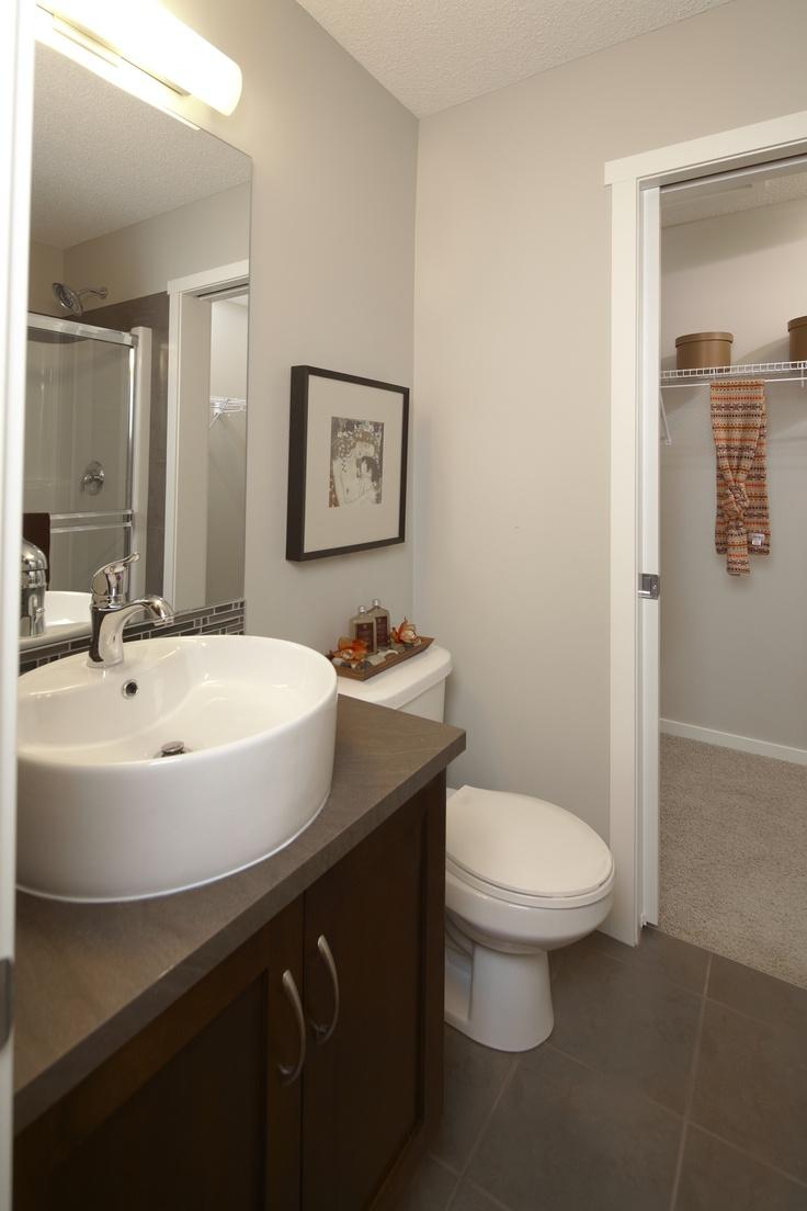 Vessel Sink And Dark Cabinets In Ensuite Bathroom At Prospect Ridge By Avi  Urban (liveatprospectridge