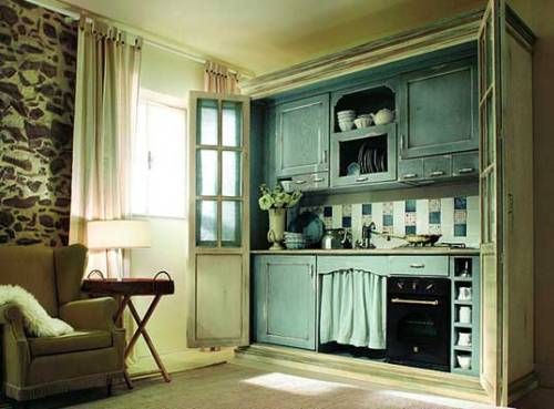 Micro-kitchen, concealed behind folding doors.  This could be fantastic in guest quarters or an in-law suite.  via lareportiste blog