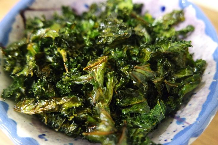 Quick, easy, healthy and delicious crispy kale crisps recipe... HA! I hear you think. AS IF. Kale? Delicious? Get real.  Okay, so I don't actually like kale – at all. It's bitter, boring, and tastes like sadness and diets. BUT. Cover it in melted butter or olive oil, and lots of salt, then burn the leaves to a frazzle, and they're actually quite tasty. Plus you can crunch your way through a whole bowl of them and tell yourself that all you're having is a bowl of salted kale. I like them as…