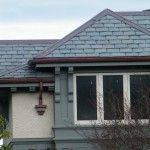 North Country Semi-Weathering Sea Green roof with copper ridge cap and gutter detail.