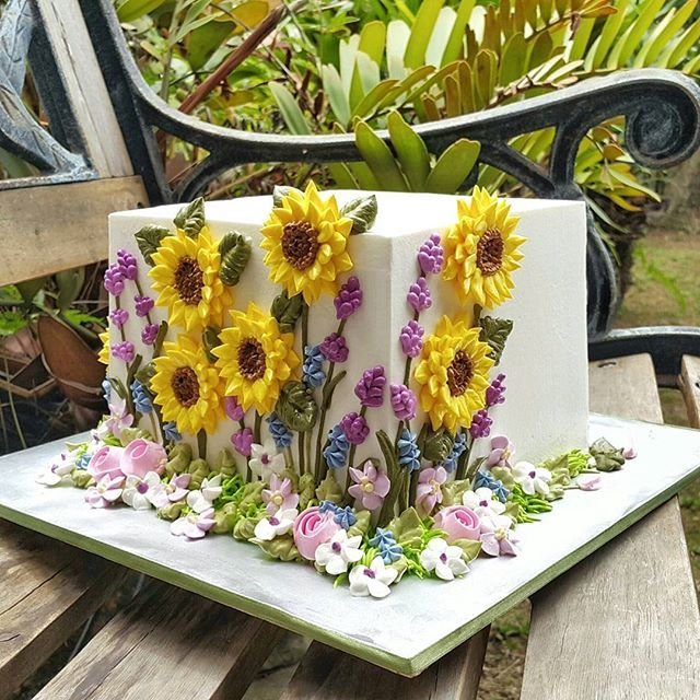 "6""x6""x6"" #sunflowercake #buttercream #sharpedges #handpiped"