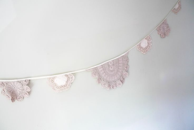 vintage doiley bunting with pearls.  Created for a local craft centre