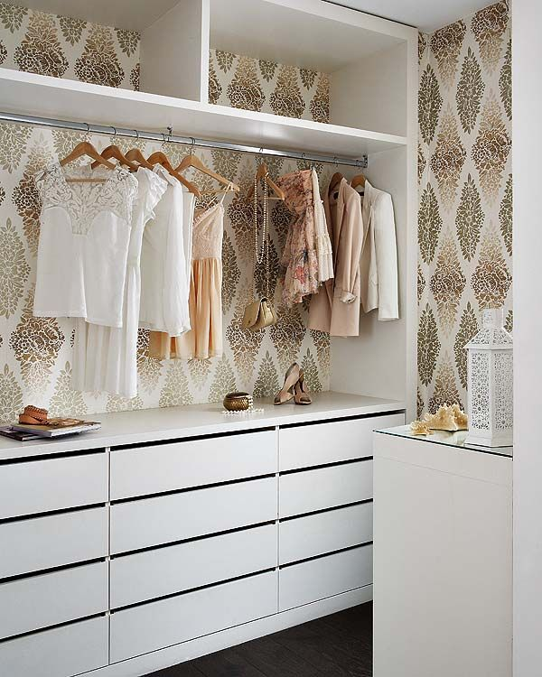 Wallpaper behind a backless closet.