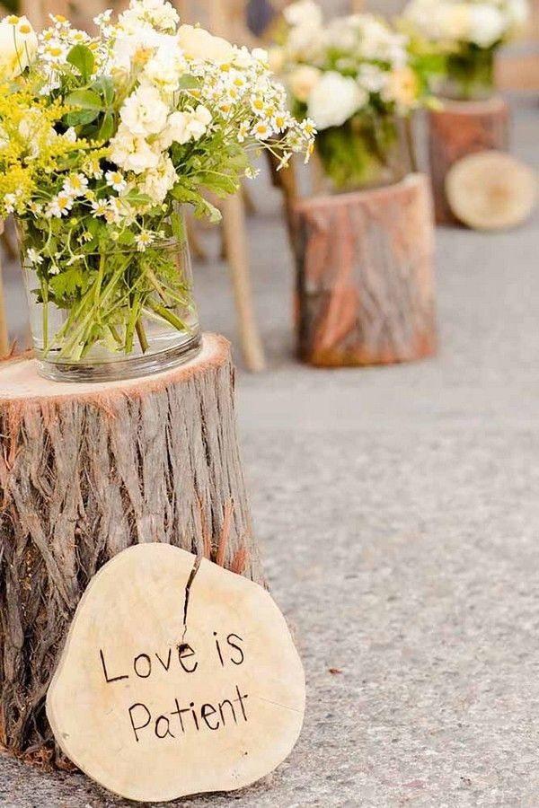 rustic tree stump wedding aisle decor with wooden wedding sign
