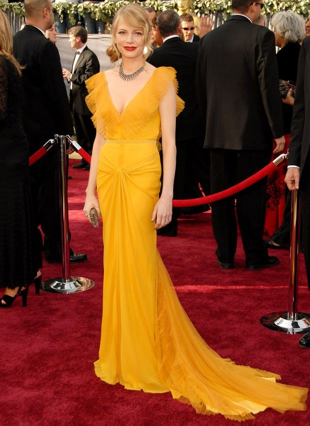 Michelle Williams The actress, who attended the 2006 show with then-boyfriend Heath Ledger, made a bold sartorial choice when she paired bright red lips with a saffron-colored Vera Wang.
