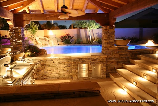 Ahh I want this all so bad!  Outdoor pool, firepit, enclosed grill and bar (throw in a big screen and a water feature in the pool) *sigh*