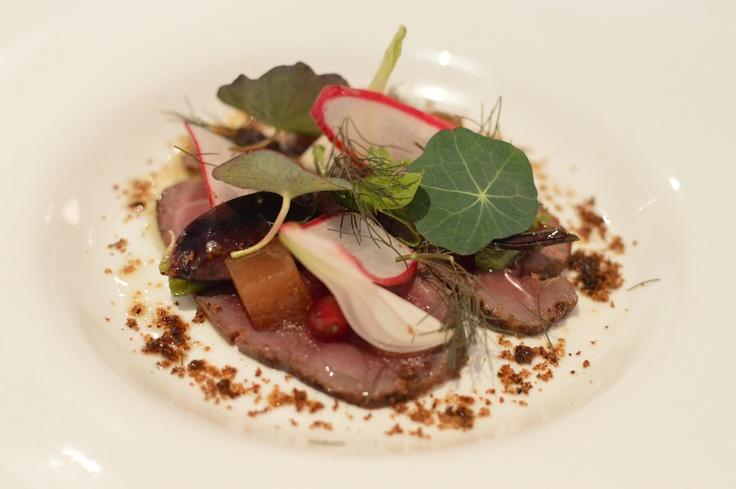 Liquorice-cured N.Z. Venison loin w Blue Mountains red currants, pickled purplette onion, rosa radish & bronze fennel