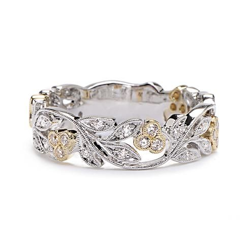 This is either the one I saw a few years ago that I wish listed haha or it is right close....  Grrr... Dang stores and not having good websites. lol  Wedding band ideas...  ouuu two-tone! Greenwich Jewelers   Beverley K White and Yellow Gold Diamond Vine Band