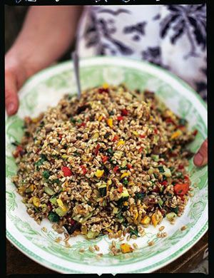 Farro is a wheat grain that is eaten in salads, soups and desserts all over Italy. It's not expensive and can be found in good delis. If you can't find it, though, use bulgar wheat, which is just as nutty in texture and cooked in the same way.