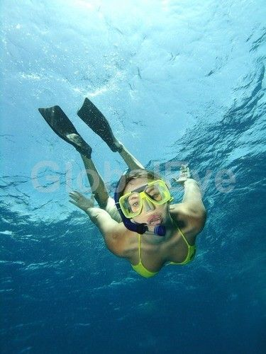 Underwater model, snorkelling. Underwater model, Woman snorkelling. Great Barrier Reef, North Queensland, Australia.Stock Photo By Christian   Botella