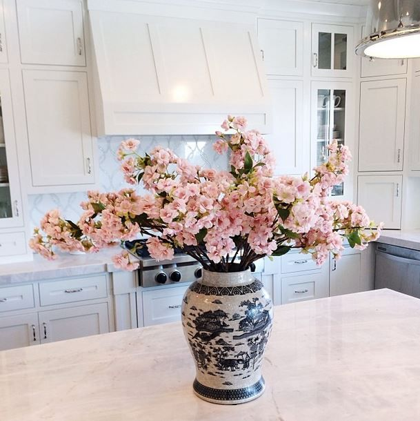 Blue and white ginger jar with pink blossoms