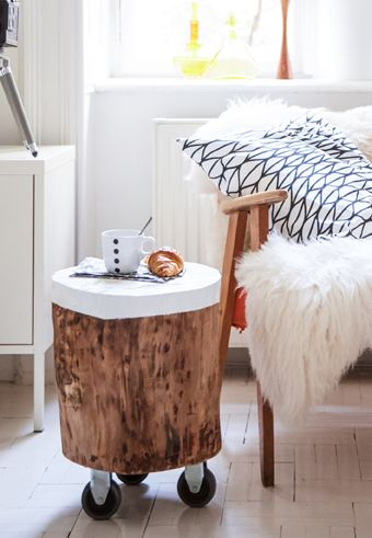 Add wheels to some scrap wood and paint the top to create a handy portable side table | #IKEAIDEAS