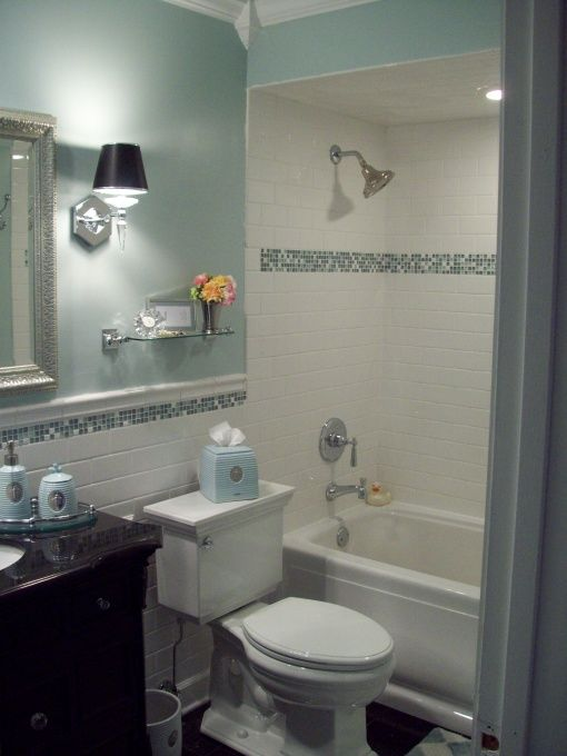 Spa blue bathroom makeover in black, white and blue with crystal accents. arctic white subway tile, glass and stone accent tile.