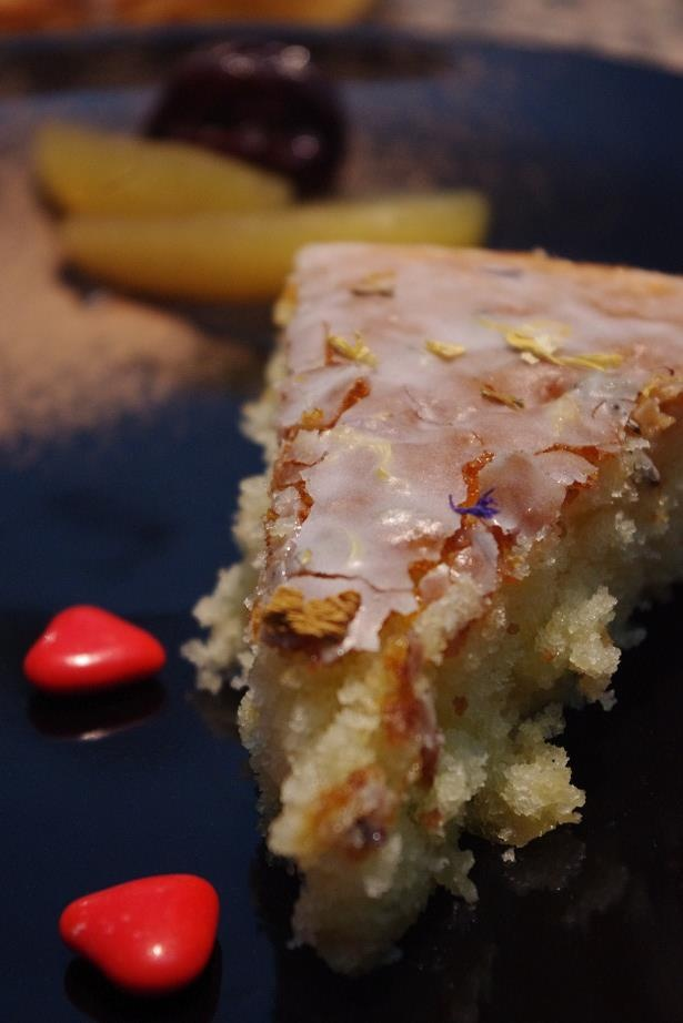 Yogurt cake with candy ginger and lavender icing