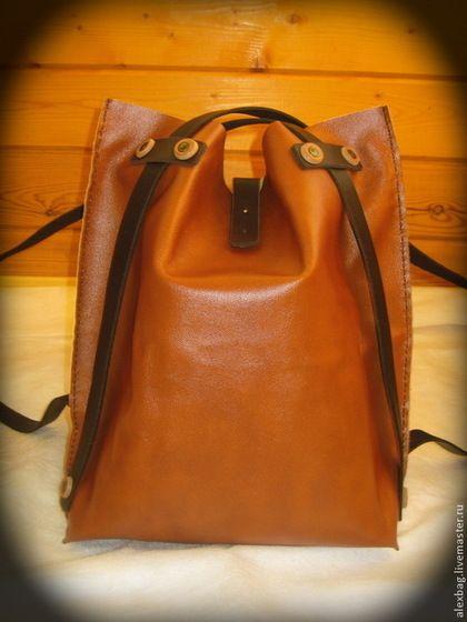Скоро Новый год!!!! Подарки в чем носить будем? А вот тут сумка шоппер, когда в руках подарки носить устанем, сумка легко трансформируется в рюкзак. По стилю унисекс, женская, мужская, кому как нравится. Есть внутренний карман, туда кошельки всякие с телефонами. Вся такая кожаная (бразильская кожа хорошей выделки), вручную собрана, с застежкой на штыречке :) Простая и выносливая, то что надо в городе. Размеры могу сделать под заказ любые.