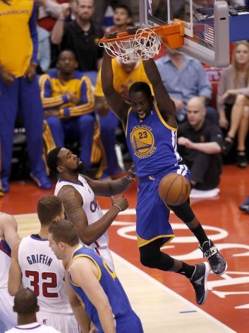Warriors' Draymond Green, (23) slams down two in the first half in front of the Clippers' DeAndre Jordan, (6) as the Golden State Warriors  ...