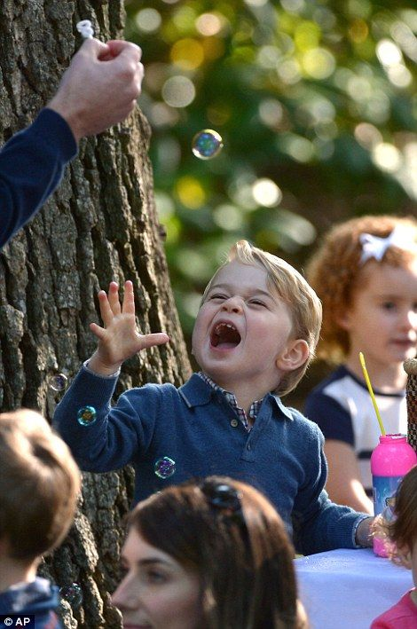 Prince George looked delighted with the bubbles at one of the activity stations...