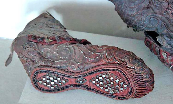 Bottom of Scythian women's boots,  Leather, cloth, tin, and gold / Pazyryk Kurgan-2 area. 300-290 BCE.