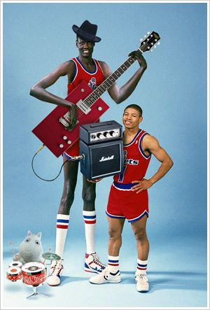 NBA greats: Manute Bol (on guitar) and Mugsy Bogues
