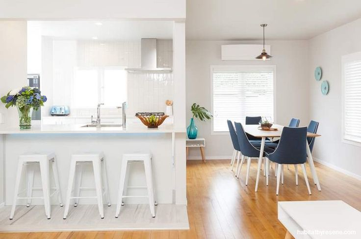 A crisp fresh colour scheme based on Resene Sea Fog certainly gives the kitchen and dining area a bright and breezy feel.