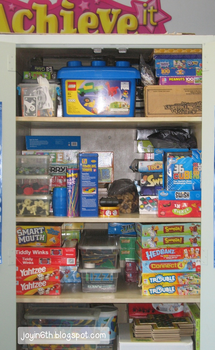 Game cupboard... organized by game type! :)