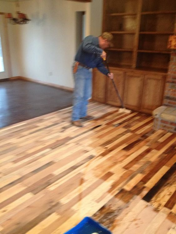 A wood floor made out of pallets. Here is a how to with pictures!: